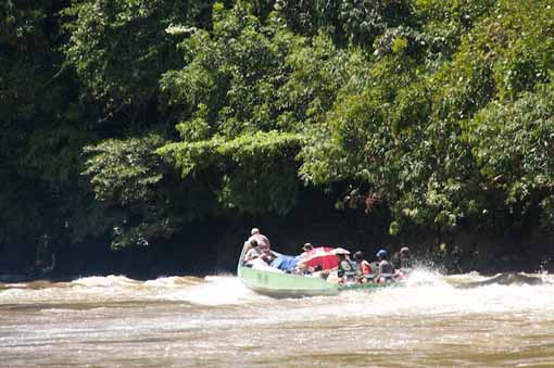 Another boat going up rapids on the Bahau river