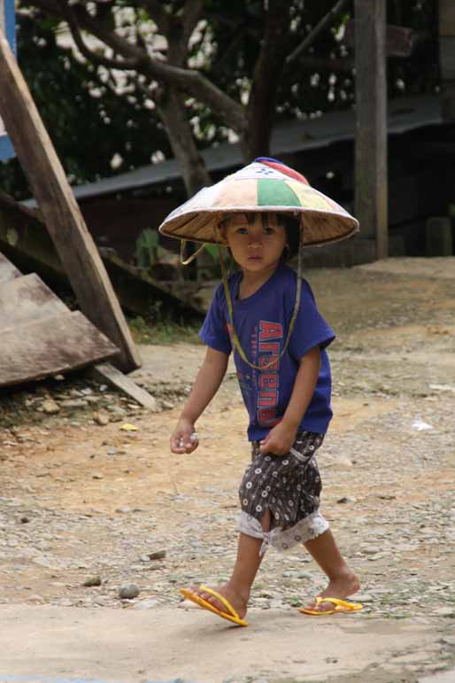 Boy with sunhat in Long Pujungan, East Kalimantan